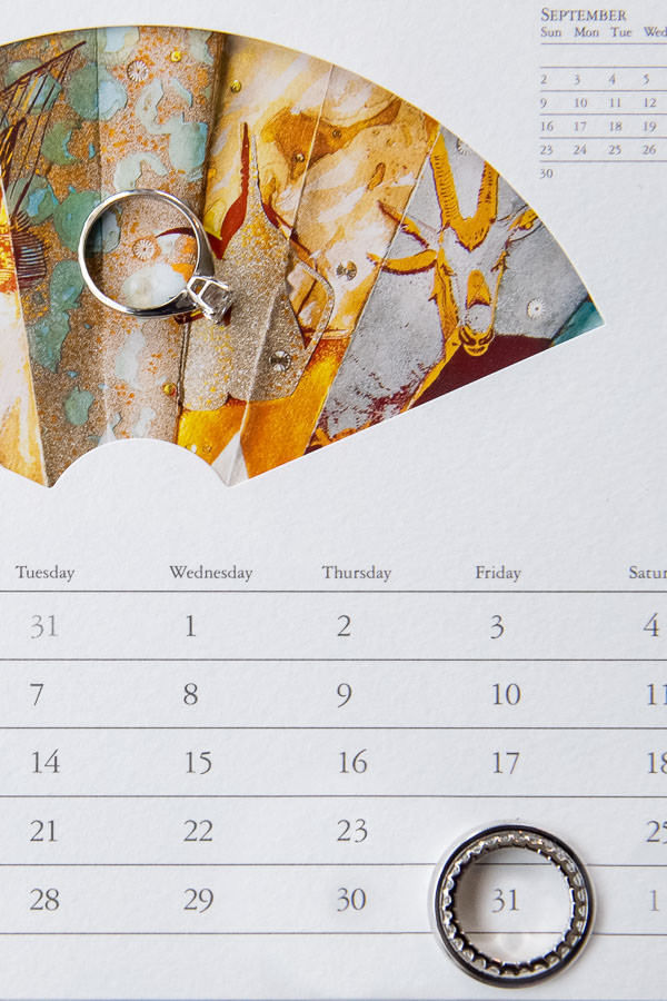 photo of wedding rings on calendar