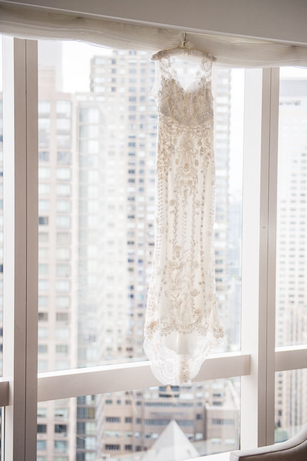 zuhair murad new york wedding gown hanging from window at mandarin oriental hotel in nyc