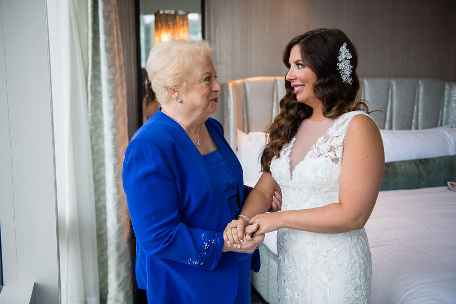 bride gets ready for her wedding with her mom at the mandarin oriental hotel in nyc