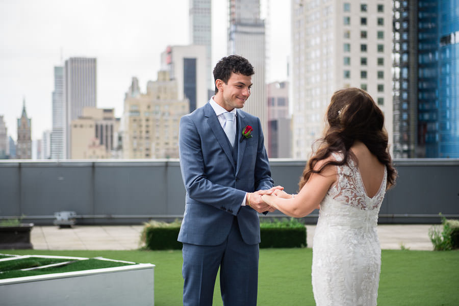 bride and groom first look on terrace on the mandarin oriental hotel in nyc