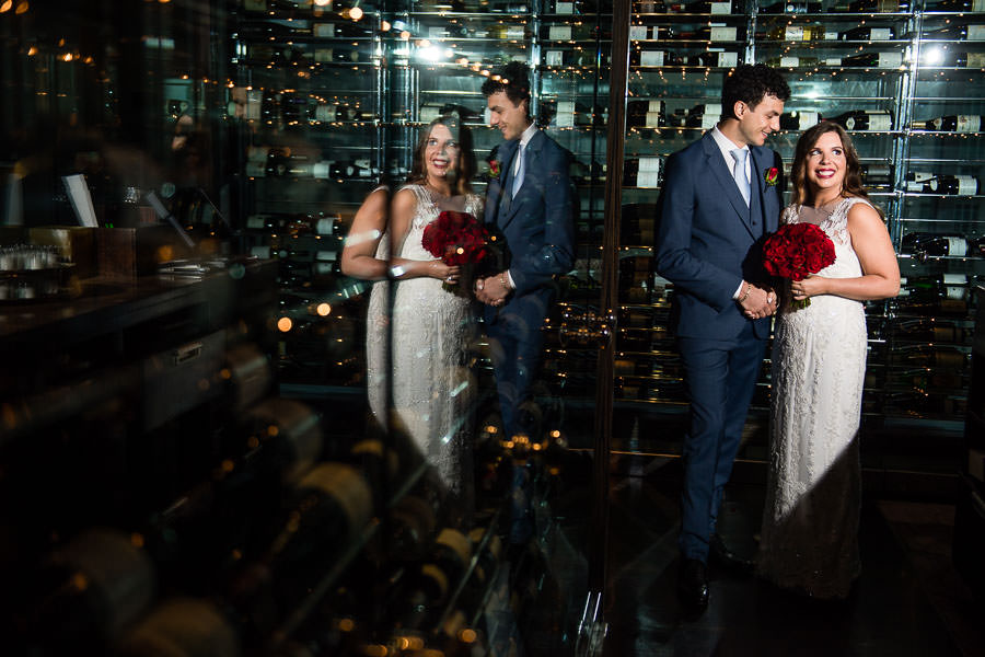 bride and groom pose for their wedding in wine room at the mandarin oriental hotel nyc