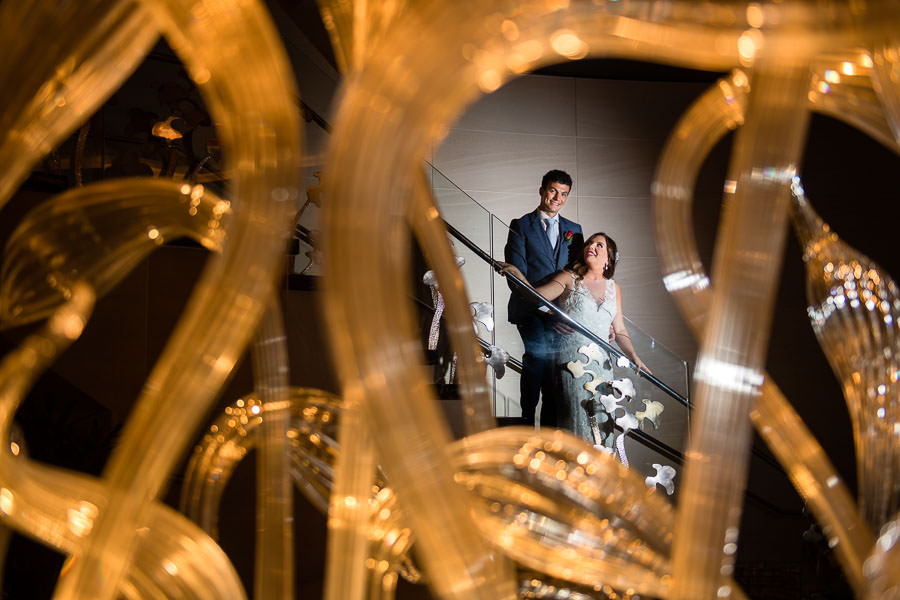 bride and groom stand on stairs in mandarin oriental hotel nyc