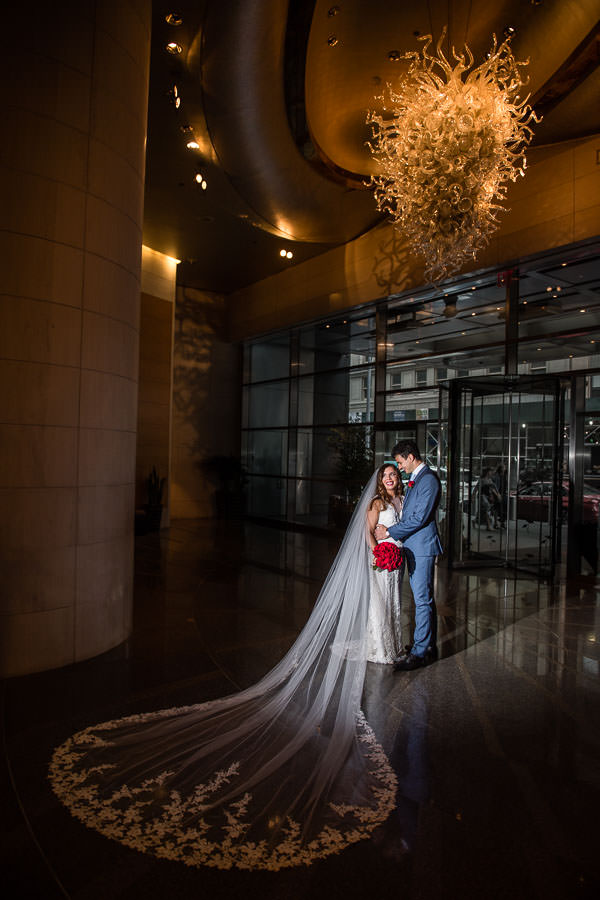 bride and groom by entrance of mandarin oriental