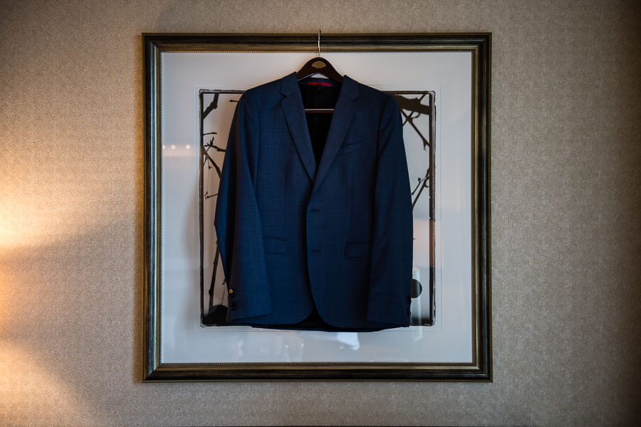 wedding detail photos of groom prep huge boss jacket