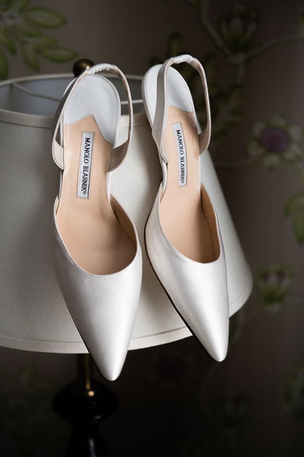 white manolo blahnik wedding heels the bride will wear at her wedding