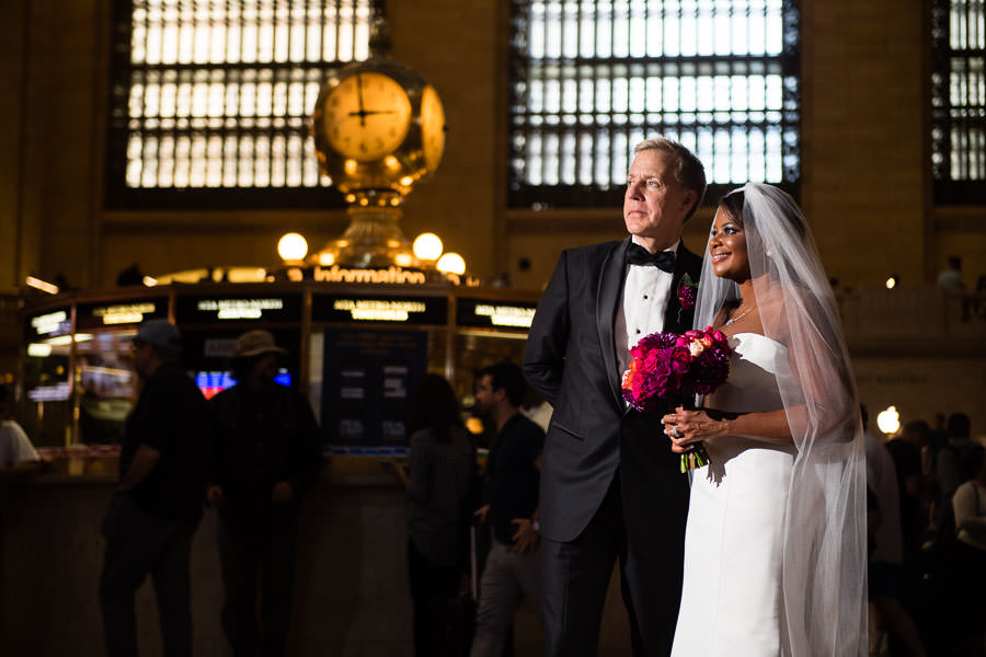 Karen and Bruce pose inside grand central in nyc