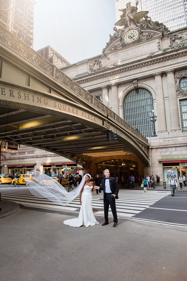 Karen and Bruce pose by pershing square grand central in nyc