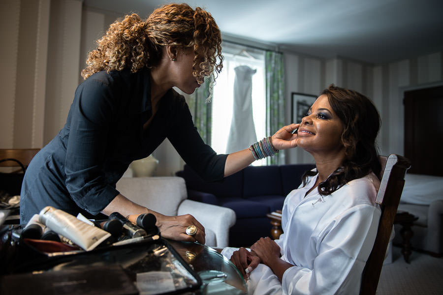 bride gets her makeup done at yale club before her wedding