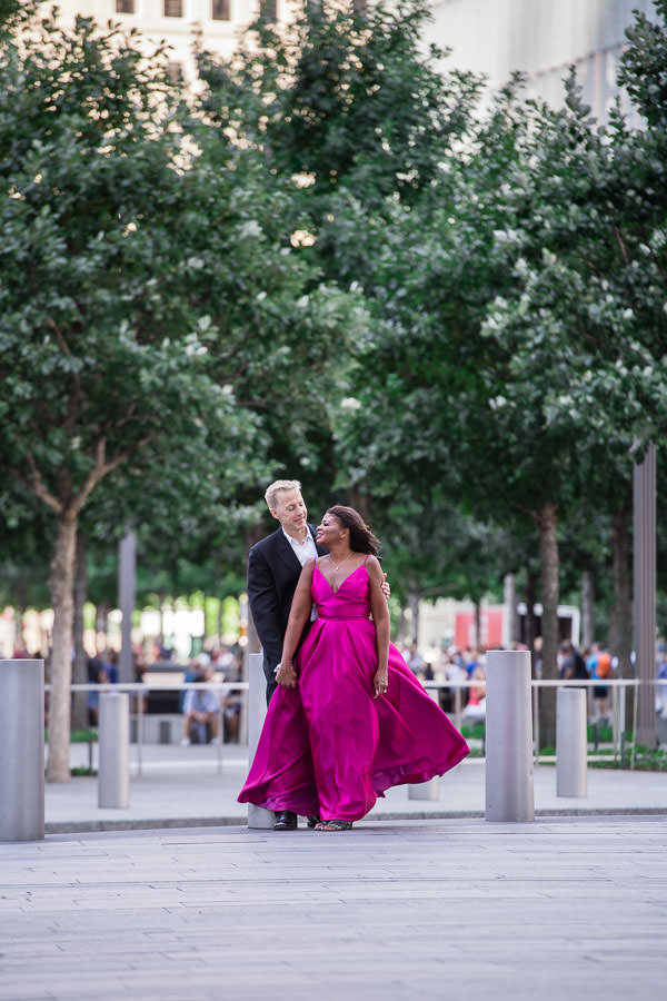 engaged couple in formal evening wear posing for their engagement session near world trade center