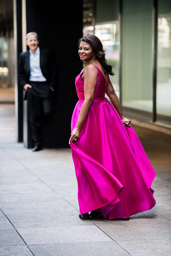 engaged couple in formal evening wear posing for their engagement session in downtown manhattan