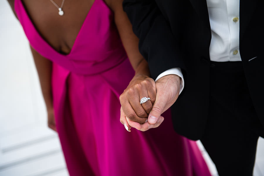 interracial couple holds each other close for their oculus engagement session in nyc