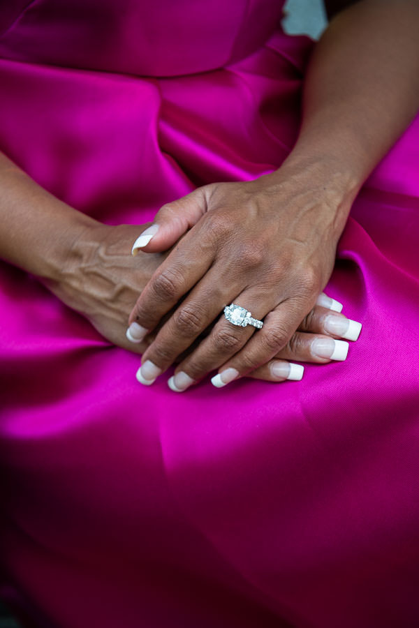 close up of engagement ring on purple dress