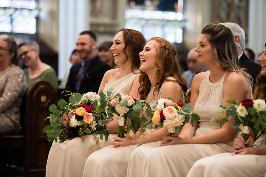 brides maids at st anthonys church in greenpoint, brooklyn during wedding ceremony
