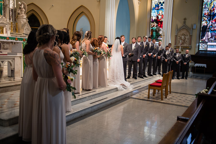 bride and groom getting married at the altar at st anthonys church wedding in greenpoint