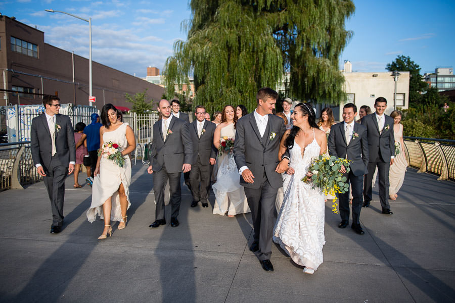bridal party walk together for greenpoint loft wedding