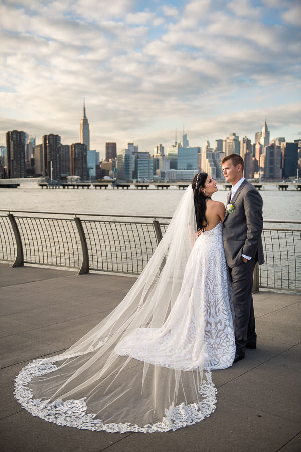 bride and groom hold hands by greenpoint loft wedding