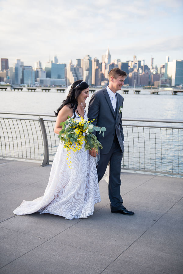 bride and groom with empire state building in the background at their brooklyn wedding