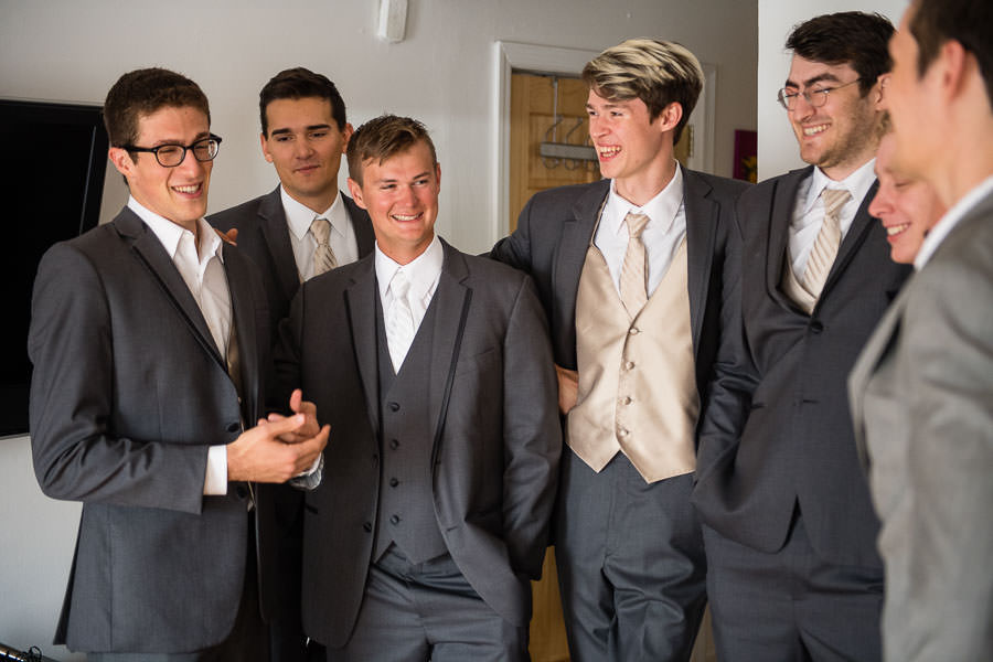 groom and groomsmen during getting ready before wedding