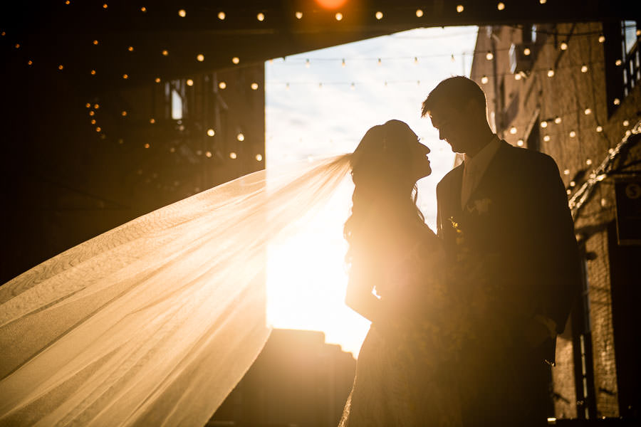 bride and groom at greenpoint loft at sunset