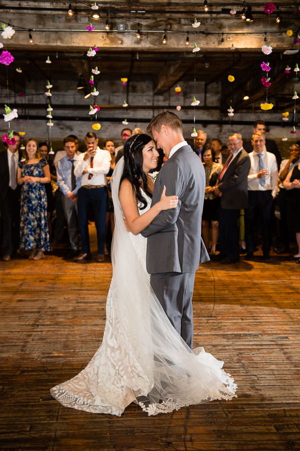 bride and groom have their first dance at their greenpoint loft wedding in brooklyn