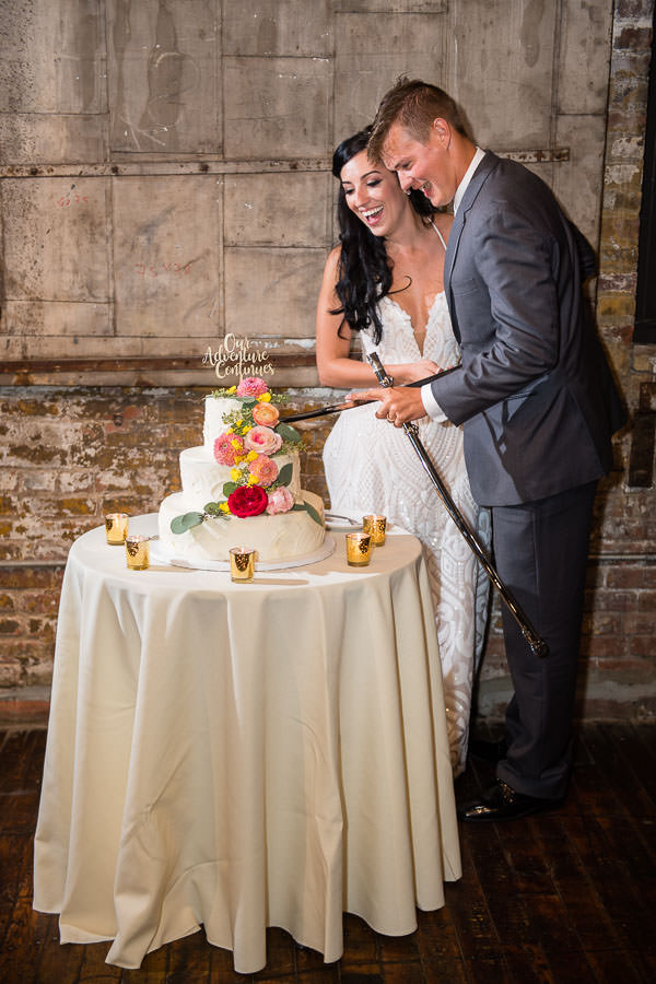 bride and groom cut cake at their greenpoint loft wedding in brooklyn