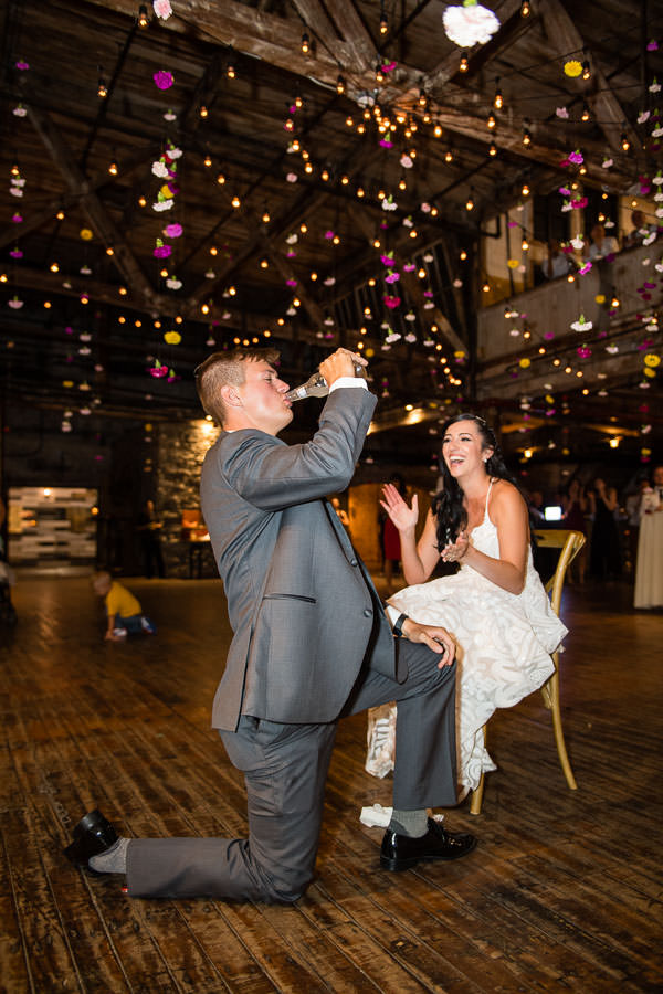 groom gets smirnoff iced at wedding at greenpoint loft