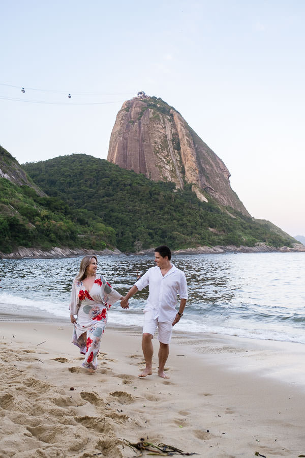 sunset engagement session on beach with couple near pao de azucar in rio de janeiro brazil by destination wedding photographer jakub redziniak