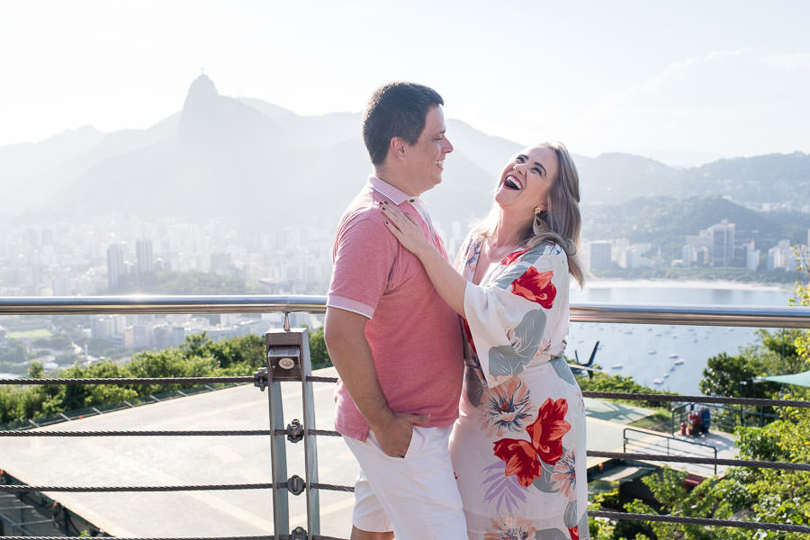 engaged couple posing at pao de azucar during sunset for destination engagement session