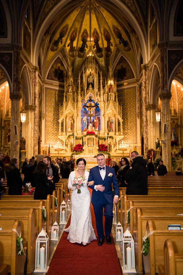 bride and groom walk down the aisle at st stanislaus kostka church wedding