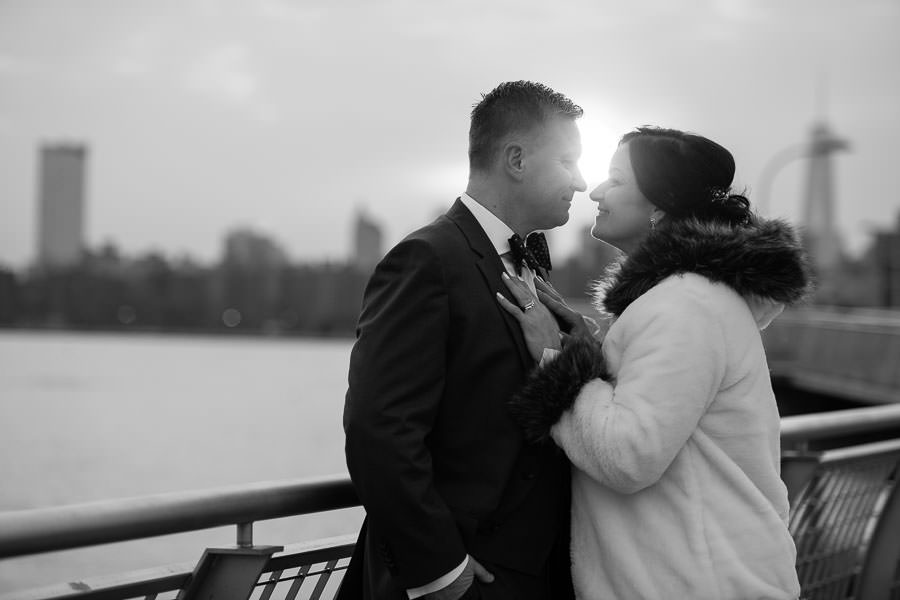 bride and groom photo session by greenpoint loft by the new york city skyline on the waterfront