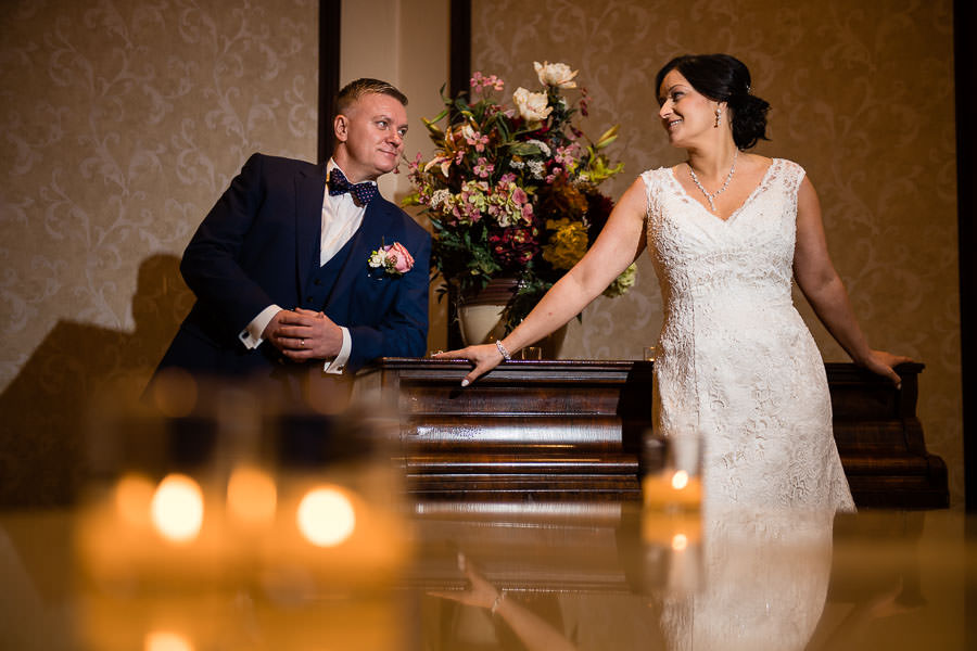 bride and groom wedding session by piano at terrace on the park wedding reception venue in new york city