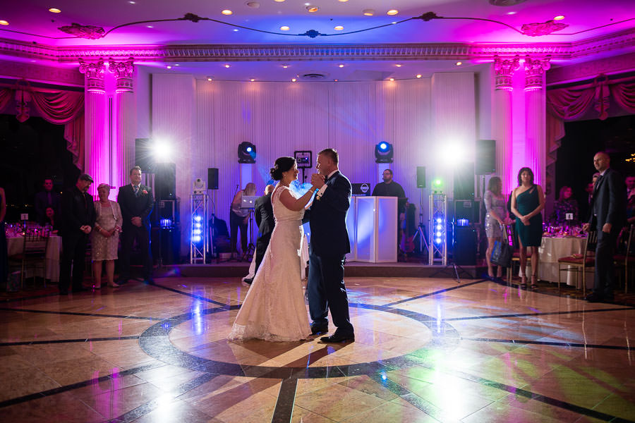 Bride and groom first dance at terrace on the park wedding reception venue in new york city with milano next band