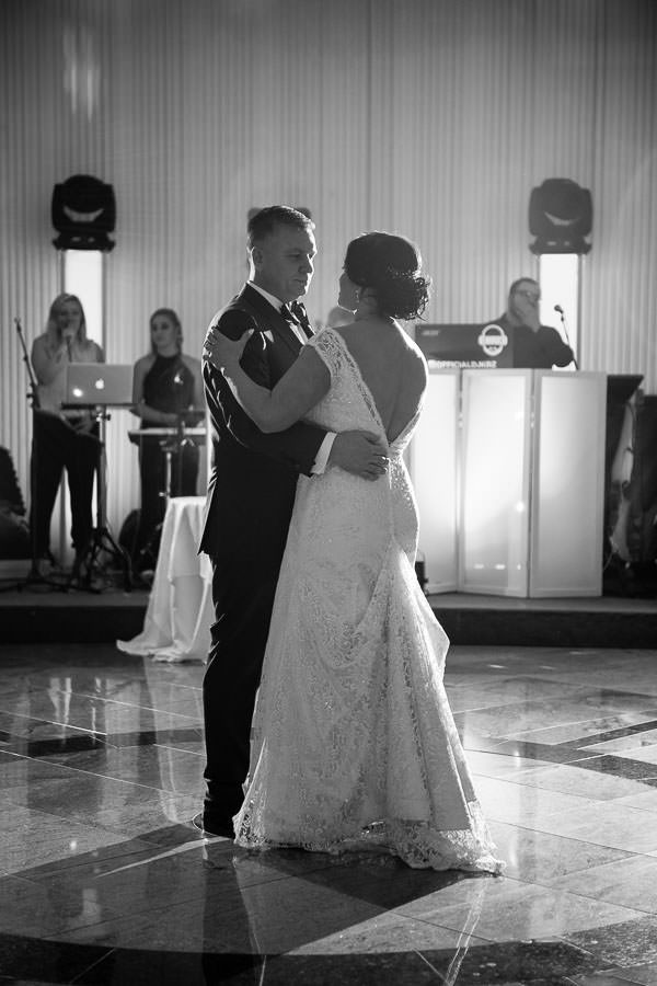 Bride and groom first dance at terrace on the park wedding reception venue in new york city