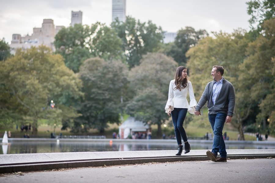 autumn central park engagement session by the model sailboat pond