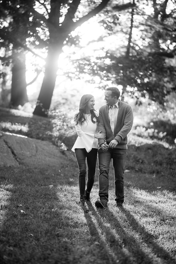 autumn central park engagement session on the grass at sunset