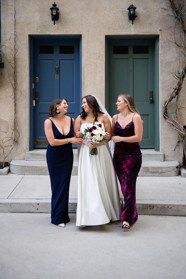 bridesmaids walk on cobblestone in manhattan