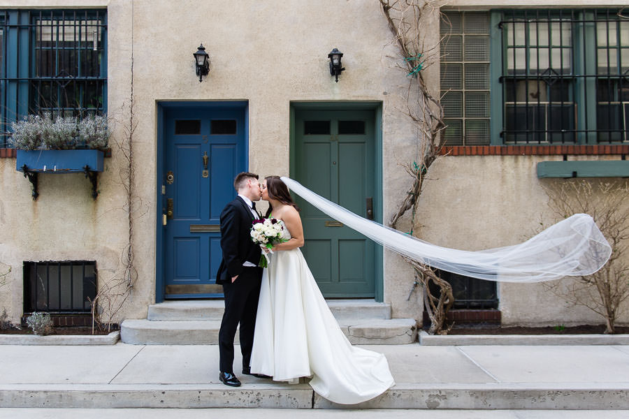 wedding couple in manhattan with veil flying