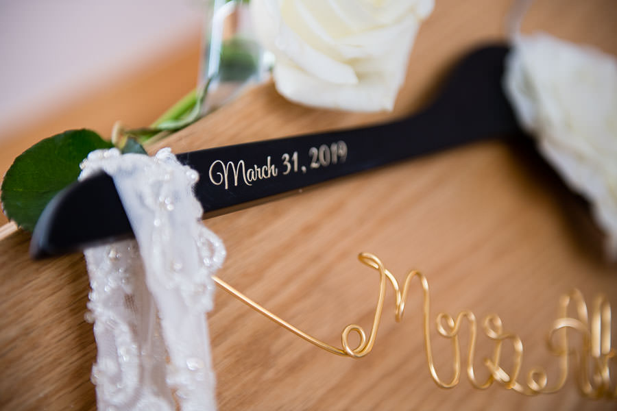 close up of wedding dress hangar with date engraved