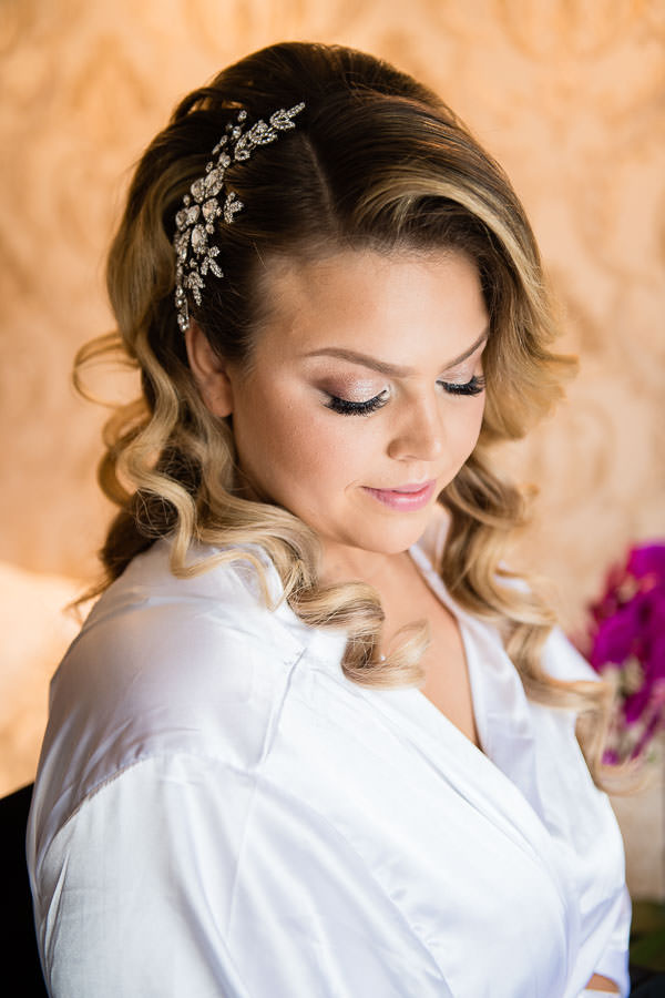 bride getting her hair and makeup done before her wedding