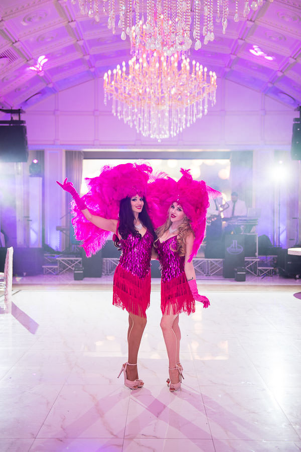 showgirls wearing pink outfits on the dancefloor before wedding reception starts