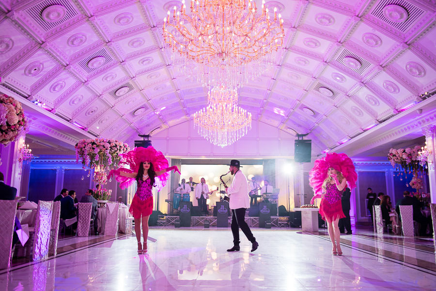 ti fusion band performs saxophone at wedding with two showgirls wearing pink outfits