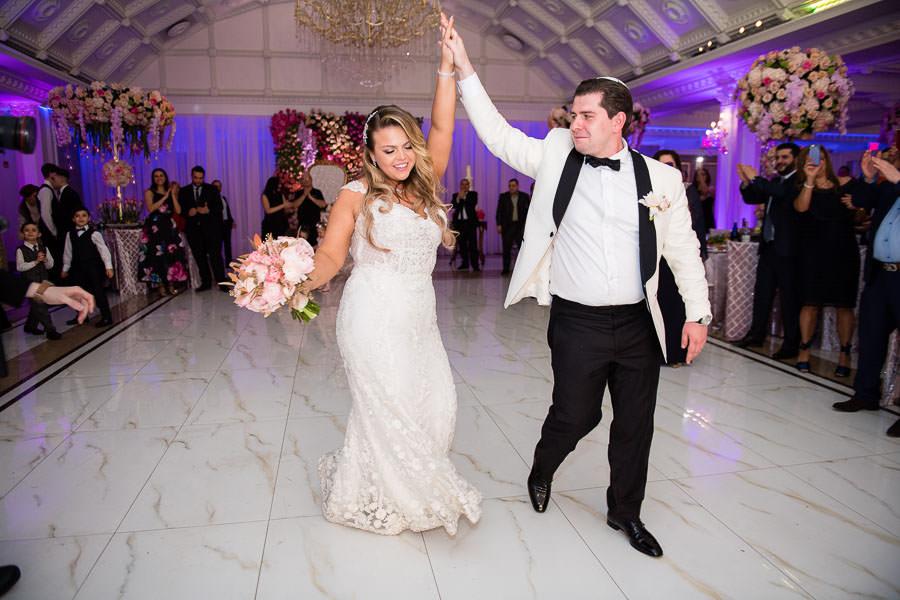 bride and groom grand entrance at metropolitan ballroom