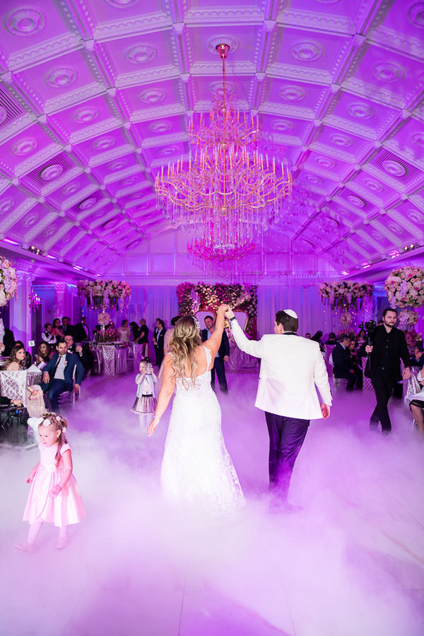 wedding first dance at metropolitan ballroom with dancing on the clouds dry ice
