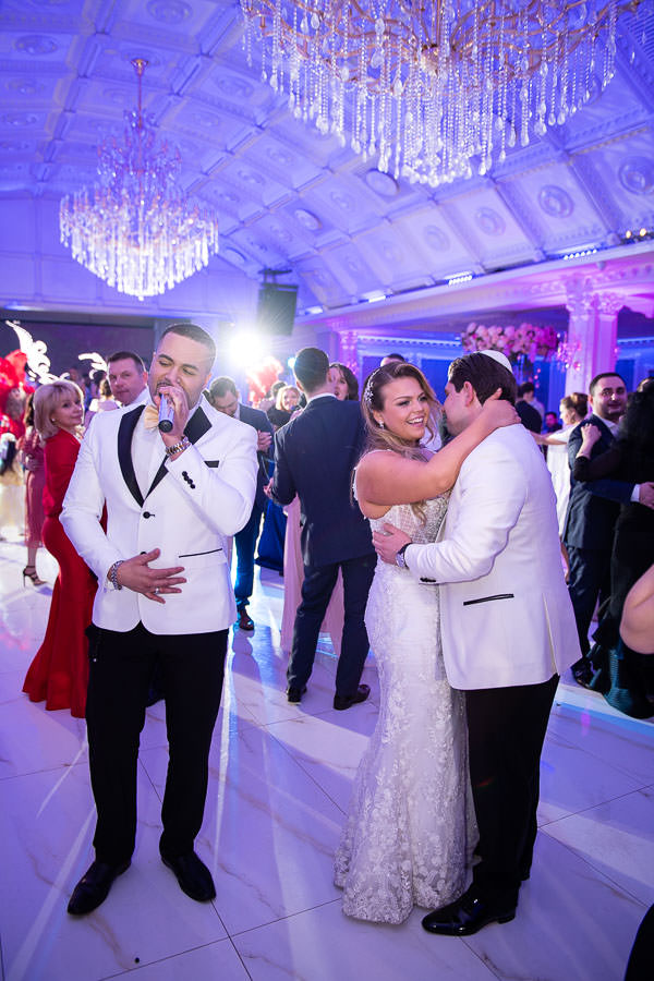 bride and groom dance on the dancefloor while Ti Fusion band sings next to them