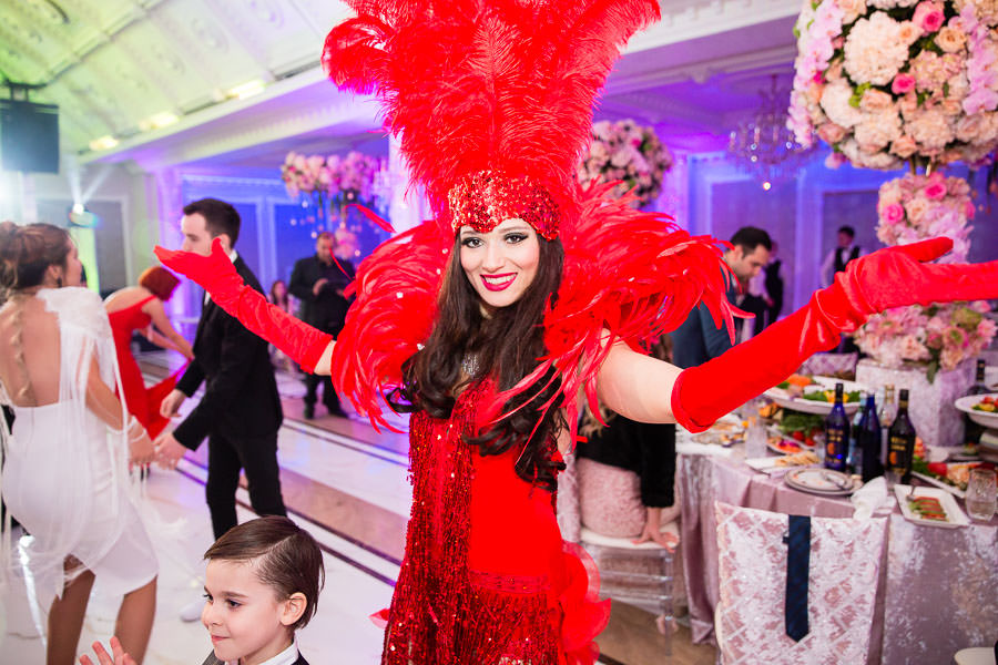 aerial artistry showgirl at wedding wearing red costume