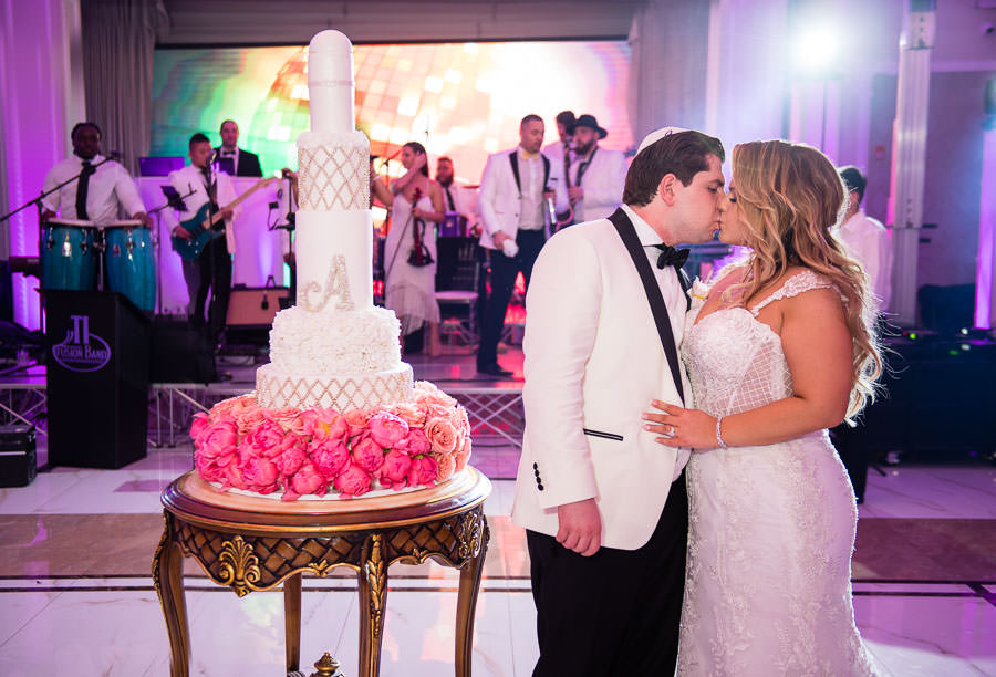 bride and groom cut their tasty pastry shoppe wedding cake at metropolitan ballroom