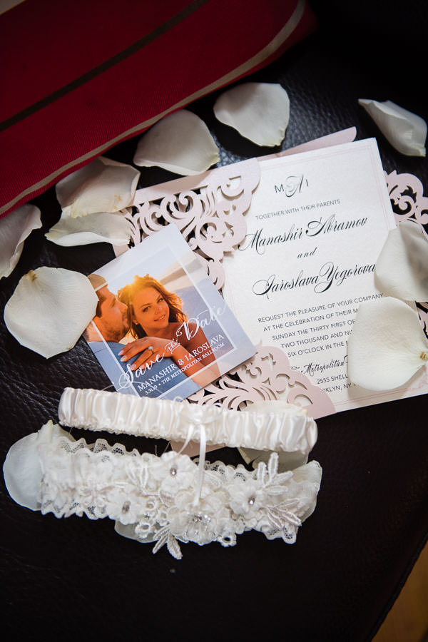 detail shot of invitations and save the date