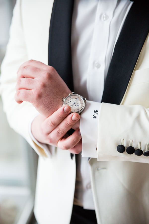 groom portraits before the wedding putting on a Patek Philippe watch