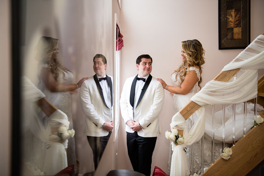 bride and groom have their first look before their metropolitan ballroom wedding