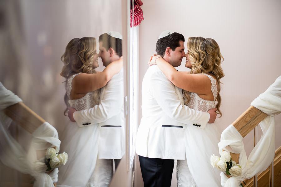 bride and groom have their first look before their metropolitan ballroom wedding